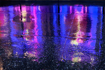 colorful reflections of lights in the rain