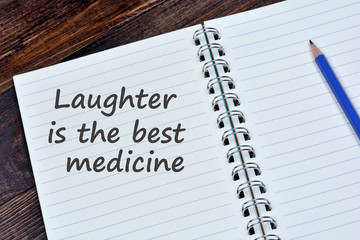 Laughter is the best medicine words on notebook