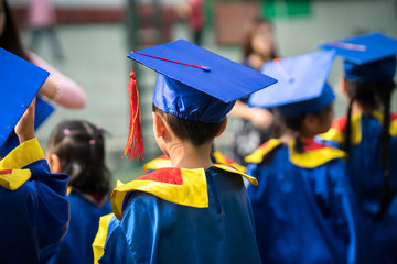Diploma graduating little student kid outdoor closeup