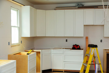 Custom kitchen cabinets in various stages of installation