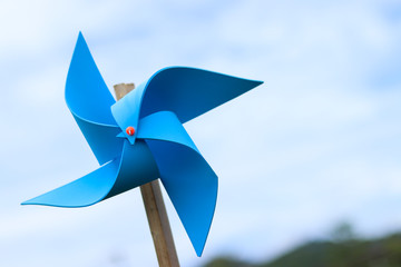 wind turbine toy with sky , save energy concept.