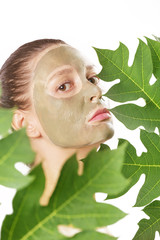 Young woman with green face mask - natural spa, beauty from nature concept