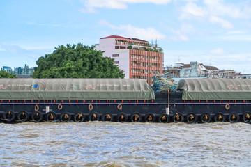 BANGKOK, Thailand - July 7, 2017 : Tug boat cargo ship in Chao Phraya river at Bangkok, Thailand