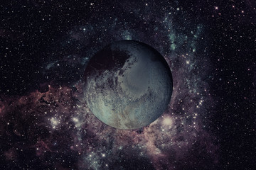 Pluto is a dwarf planet in the Kuiper belt. Elements of this image furnished by NASA