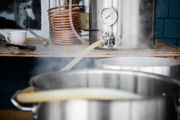 Papiers peints Biere, Cidre Home Brewing Kit and Pouring Craft Beer Wort into the Boil Kettle.