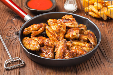 Baked wings, served with dip or baked potatoes.