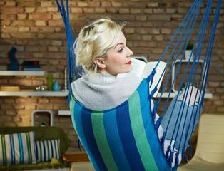 Casual woman resting in hammock like chair