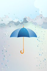 Blue opened umbrella and clouds with rain