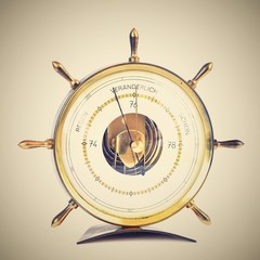 Beautiful old barometer. The shape of the rudder. Isolated on a clean white background