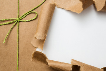 Package ripped on white background