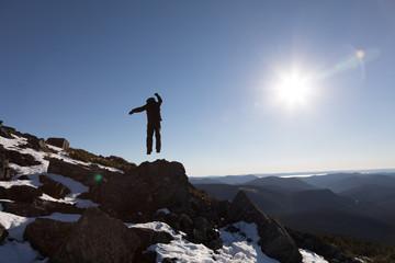 Victorious Man Enjoying the Success of the Richardson Mountain's Summit