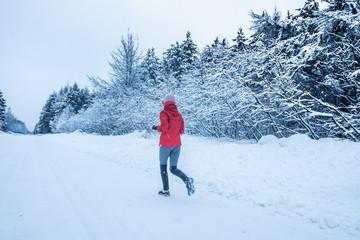 Woman Running Alone with Motion Blur during Cold Snowy day of Winter in Canada