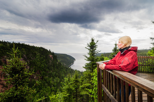 Young Woman Looking at the Amazing Nature from an Observation Tower