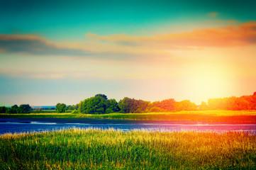 River landscape. Summer sunset nature background.