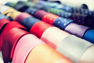 Neckties on hangers in men clothing store