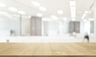 Wood table top and blurred bokeh office interior space background - can used for display or montage...