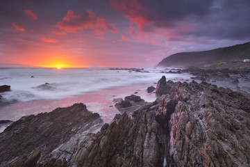 Sunset over the ocean in Garden Route NP, South Africa
