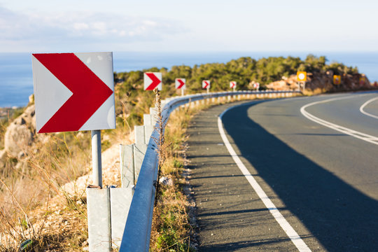 Right Turn Sign: Road signs warn of a sharp turn on a narrow road