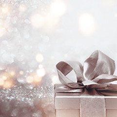Gift on abstract silver glitter bokeh background