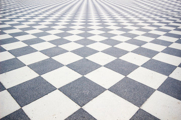Black and White ceramic floor condition with grid line for background. Black and white walkway checkered pavement floor tiles seamlessly as a pattern.