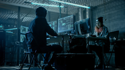 Group of Teenage Hackers Organize Attack on Corporate Data Servers. Their Lair is Dark and Full of Operating Displays.
