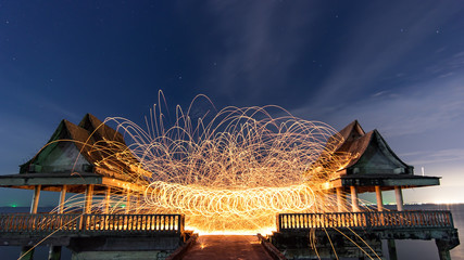 Burning steel wool fireworks,Line of light in circle from fire swing dancing, Art shown at night time.