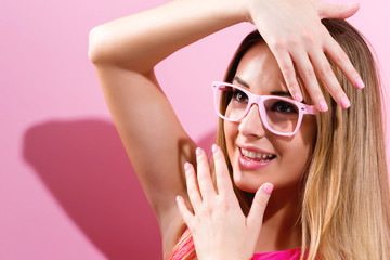 Wall Mural - Beautiful young woman on a pink background