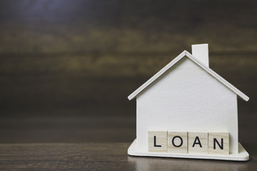 House model with loan word on wooden blocks