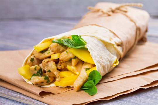 Chicken, mango, cheese, basil and mint burritos.  Wraps with chicken