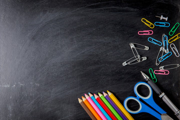 School supplies side border on a chalkboard background. School supplies on blackboard background. back to school, education concept