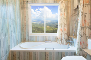 Interior of bathroom with mountian landscape view