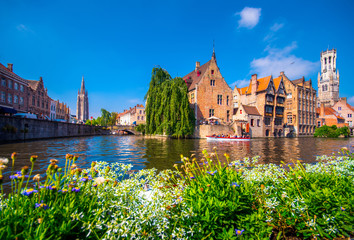 View from the Rozenhoedkaai in Brugge with the Perez de Malvenda house and Belfort van Brugge in the background in day light