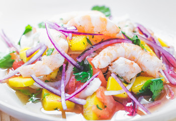 Refreshing dish of fish marinated in citrus juice. Shrimp and Mango Ceviche. Diet and healthy food concept