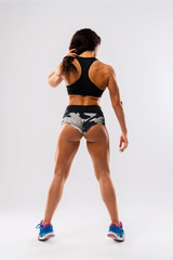 Perfect Fitness Body of Beautiful Woman. Fitness Instructor in Sports Clothing. Female Model with Fit Muscular and Slim Body Posing in Sportswear. Young Fit Girl. Back View