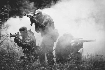 Soldiers on fire amidst smoke
