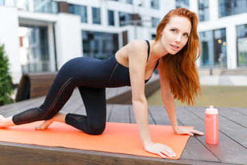 Girl doing exercises on rug