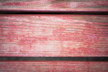 Close up light pink wooden background