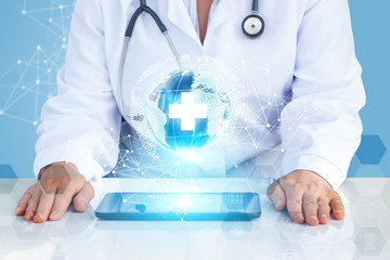 Doctor with tablet in the global network.