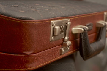 Leather brown retro suitcase close up