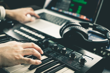Fototapeta Music producer is recording sound on Computer obraz