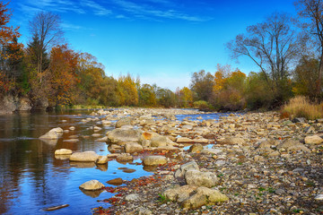 mountain river in autumn. Rocky shore.