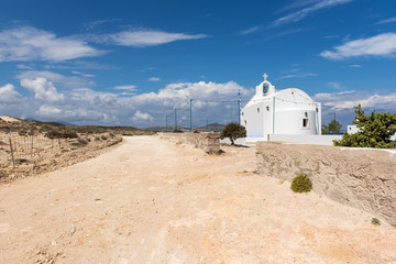 Traditional Greek white church in Agios Konstantinos on the island of Milos. Cyclades, Greece.