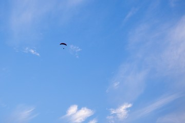 Paraglider flying in the air during colorful sunset. Slovakia