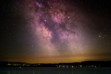 The center of the Milky Way above the Lake Constance as seen from the peninsula Mettnau at Radolfzell in Germany.