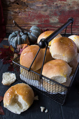 basket of buttered rolls in fall setting