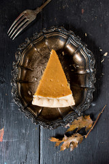 Pumpkin Pie slice in elegant setting from above