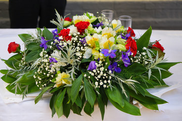 Beautiful bouquet of fresh tropical flowers on festive table