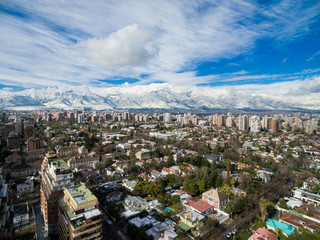 Aerial drone shot of Santiago de Chile at winter. Snowy cityscape of the city