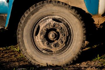 Dirty truck's wheel background soil sunshine day