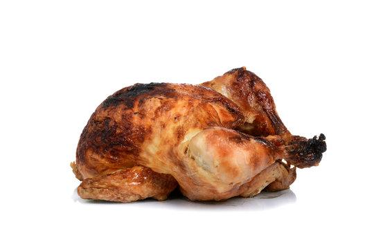 baked rotisserie chicken dinner on white background